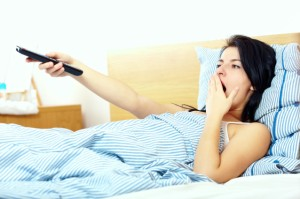 woman watching tv in the morning